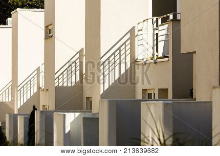 Modern semi detached houses in minimalistic shape outdoor shot on sunny day.