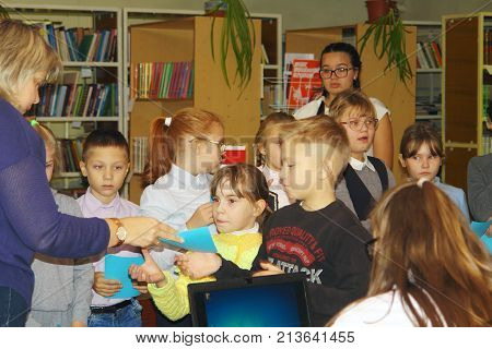 Schoolkids Are Engaged With The Teacher