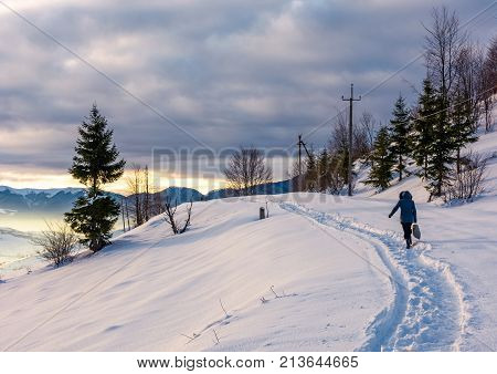 Person Go Through Snowy Rural Hillside
