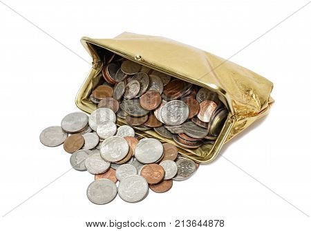 Horizontal shot of an open gold metallic coin purse laying on its side with coins spilling out of it on a white background.