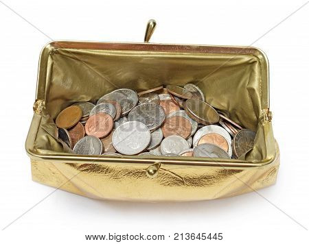 Horizontal overhead shot of an open gold metallic coin purse with shadow filled with coins on a white background.