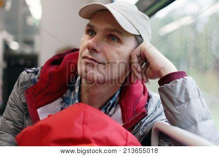 Mature man in a commuter train