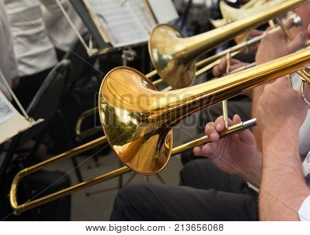 musician plays the trumpet in the orchestra .