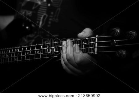 Bass Guitar Player Playing Bass In Music Studio