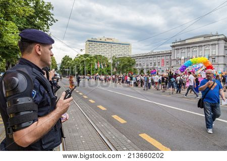 ZAGREB, CROATIA - JUNE 11, 2016: 15th Zagreb pride. Intervention policemen in front of Mimara museum securing LGBTIQ activists and supporters during the gay pride.