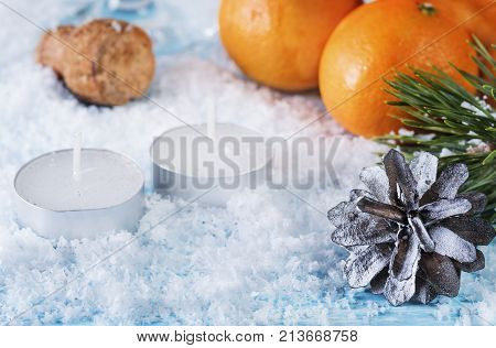 Christmas greeting card. Oranges cone. Christmas background