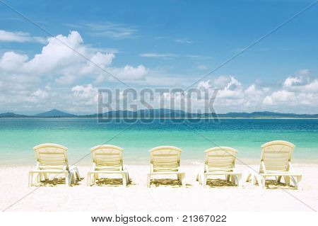 concept photo of beach with chair