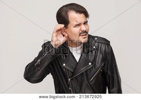 What? Dont Hear You! Man In Leather Jacket Looking At Camera