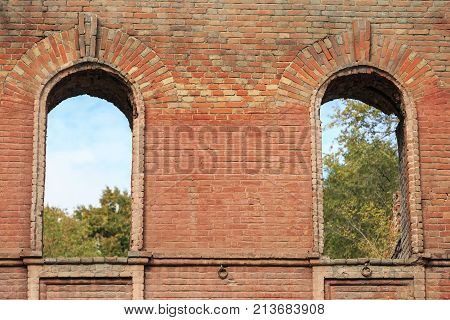 Two through window embrasures in the old brick wall of an ancient house