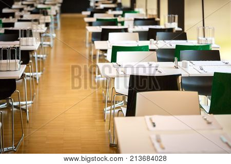 The interior of modern spacious canteen no people