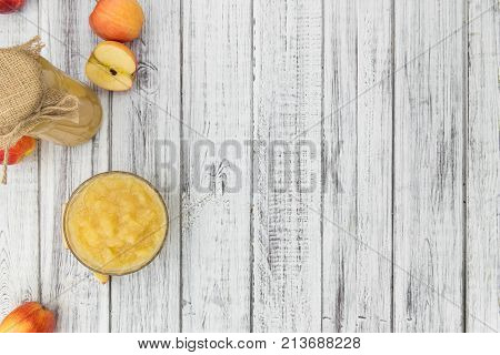 Old Wooden Table With Fresh Made Applesauce