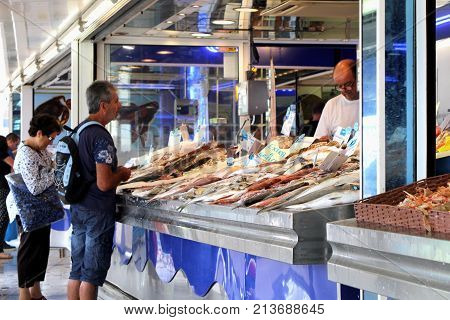 Valras-plage, Herault, France - Aug 25 2017: Man Buying Fresh Fish From A Fishmonger In France
