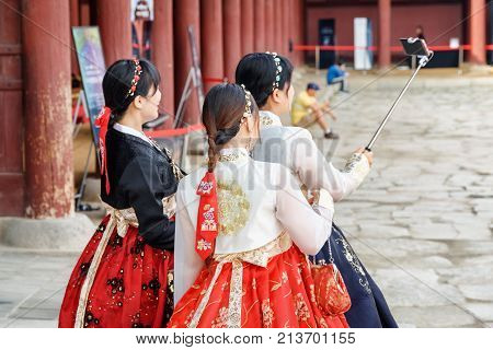 Girls Wearing Korean Traditional Dress And Taking Pictures