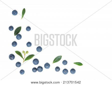 Fresh Blueberries with leaves isolated on white background. Flat lay top view