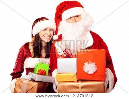 mr and mrs santa claus with a pile of gifts