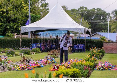 Labuan,Malaysia-Nov 12,2017:Scout leader taking photo with DSLR camera during the Remembrance Day at Labuan War Memorial park in Labuan,Malaysia.