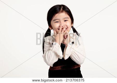 Studio portrait of happy Asian girl shot