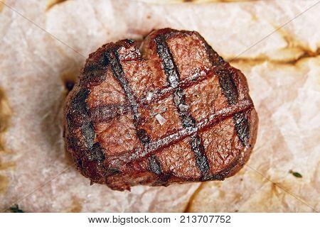 Gourmet Grill Restaurant Steak Menu - Filet Mignon Beef Steak on Parchment. Black Angus Prime Beef Steak. Beef Steak Dinner. Top VIew