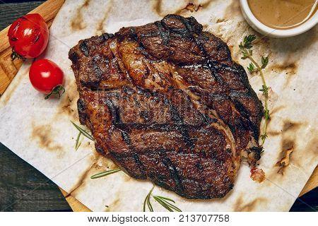 Gourmet Grill Restaurant Steak Menu - Rib Eye Beef Steak on Wooden Background. Black Angus Prime Beef Steak. Beef Steak Dinner. Top VIew