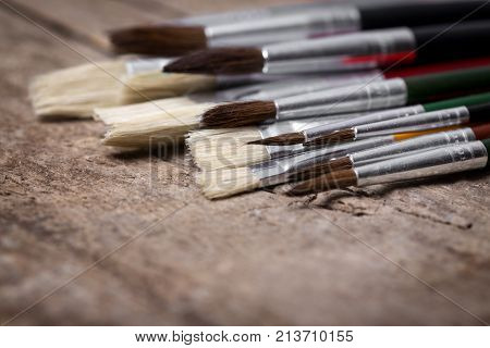 Brushes On A Wooden Background