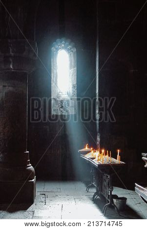 A Dark Background Of Old Armenian Christian Church Monastery Interior With A Sun Ray Falling To The
