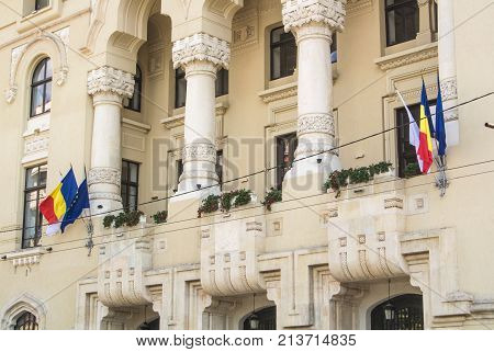 Bucharest, Romania - July 29, 2017: Archetecture, State Flags And Trees In The Central Street Of Buc