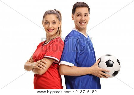 Female footballer and a male footballer with their backs against each other looking at the camera and smiling isolated on white background