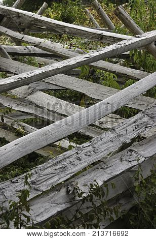Vertical close up of an old broken and worn Civil War fence in a battlefield area near Gettysburg, Pennsylvania a little before sunset on a cloudy late afternoon in September.