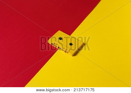 Yellow Audio Cassette Tapes On Red And Yellow Background Top View. Creative Concept Of Retro Technology