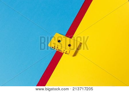 Yellow Audio Cassette Tapes On Colored Background Isometric View. Creative Concept Of Retro Technology