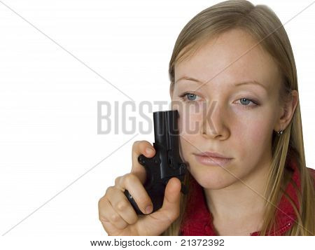 Dreamy young woman with gun