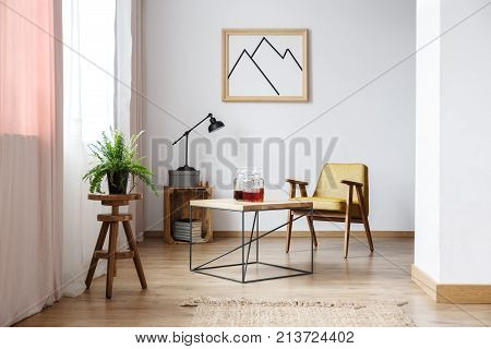 End Table, An Armchair And A Picture Above