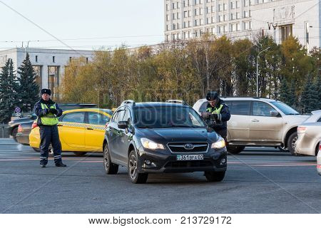 Moscow, Russia -November 2. 2017. Employees of State Traffic Safety Inspectorate check documents from a Kazakhstan driver