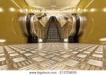 Escalators in a subway station poster