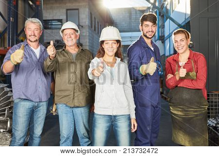 Team of blue collar workers with thumbs up as motivation