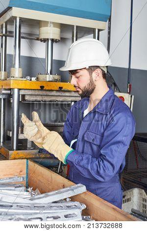 Man as worker and apprentice in metalworking workshop