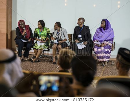 A Group of Business Woman Having a Discussion in a Panel with Audiences