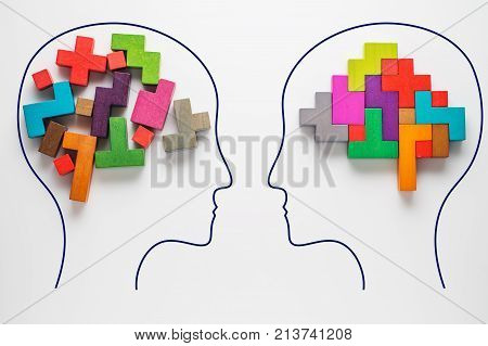 The concept of rational and irrational thinking of two people. Heads of two people with colourful shapes of abstract brain for concept of idea and teamwork. Two people with different thinking. poster