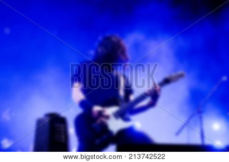 Blurred Silhouette Of A Guitarist