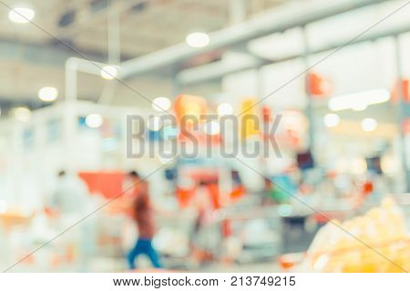 Blurred Background, Customer Pay Money At Cashier In Supermarket Store With Bokeh Light
