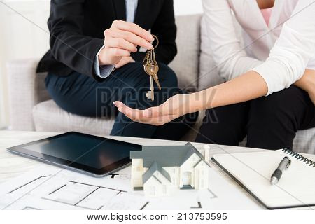 Closeup Photo Of Saleswoman Giving House Key