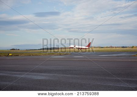 Airplane Taking Off From Wet Runway