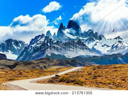 Fine highway to the majestic Mount Fitz Roy. Argentine Patagonia. Summer day in February. The concept of active and extreme tourism. The summer sun illuminates the prairie