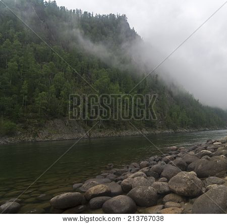 Very Low Clouds Over A Mountain River.