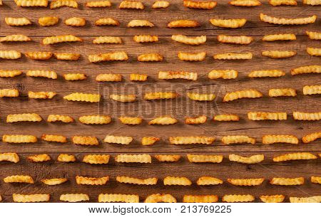 French fries in rows - food background