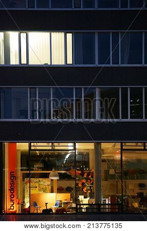 DARMSTADT, GERMANY - OCTOBER 31: A neon illuminated shop for office design in the night at the train station on October 31, 2017 in Darmstadt.