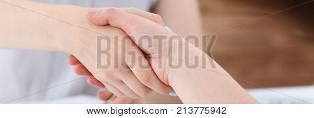 Businesswoman and woman shake hands as hello in office closeup. Friend welcome introduction greet or thanks gesture product advertisement partnership approval arm strike a bargain on deal concept