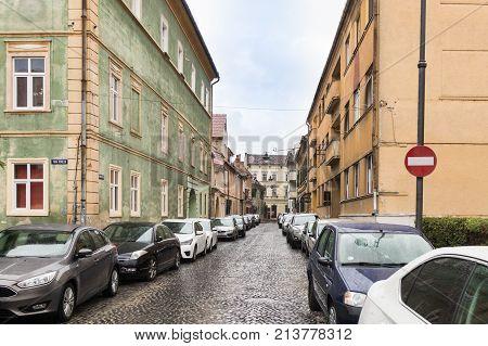 Sibiu Romania October 07 2017 : Timotei Popovich street in a rainy day in Sibiu city in Romania