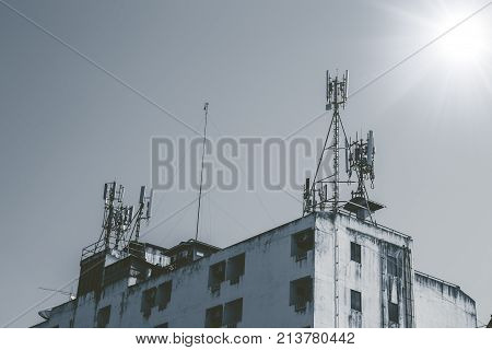 Communication Tower On Top Of Old Building Telephone Industry In Poor Country Concept