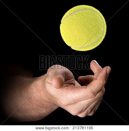 Hand Tossing Tennis Ball